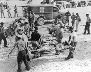 300px-uss_indianapolis-survivors_on_guam.jpg